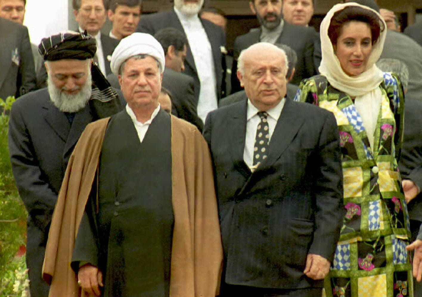 From left, Afghan President Burhanuddin Rabbani, Iranian President Ali Akbar Hashemi Rafsanjani, and Turkish President Suleiman Demirel walk with Pakistani Prime Minister Benazir Bhutto as they left a conference room after informal discussions on the second and final day of the summit of the 10-nation Economic Cooperation Organization (ECO) in Islamabad in 1995 (Photo: Tanveer MUGHAL / naq / mf / AFP)