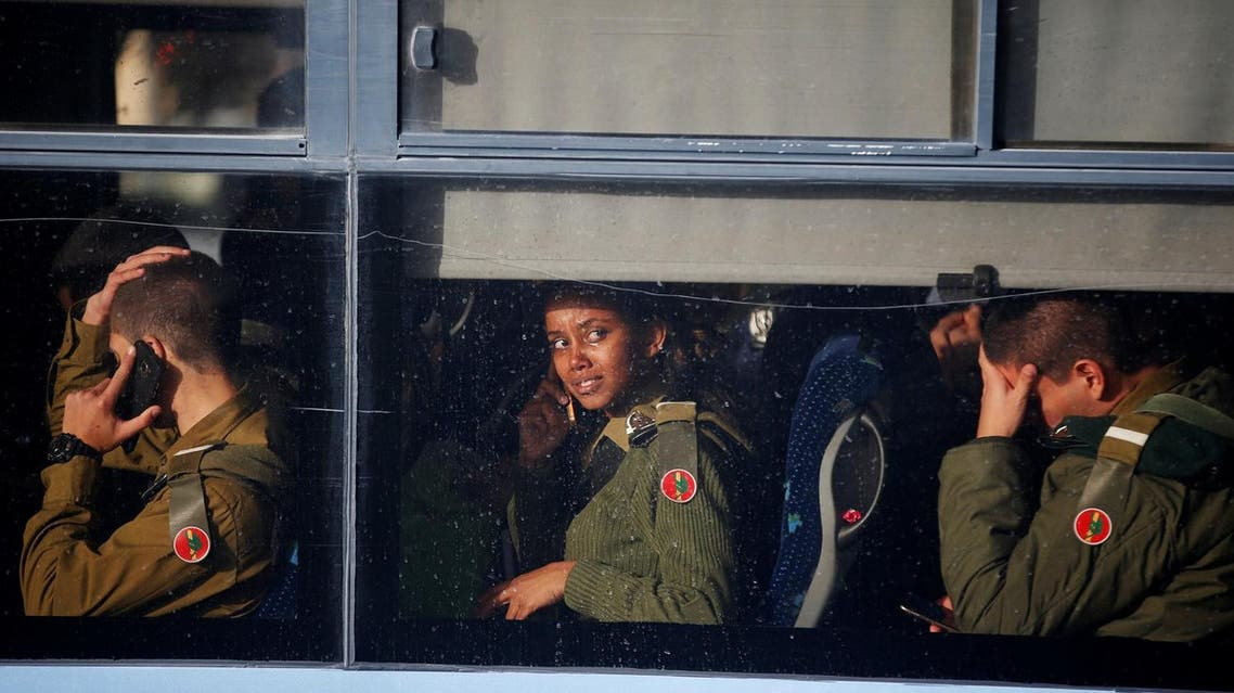 Israeli soldiers sit in a bus as they leave the scene of a truck-ramming incident in Jerusalem. (Reuters)