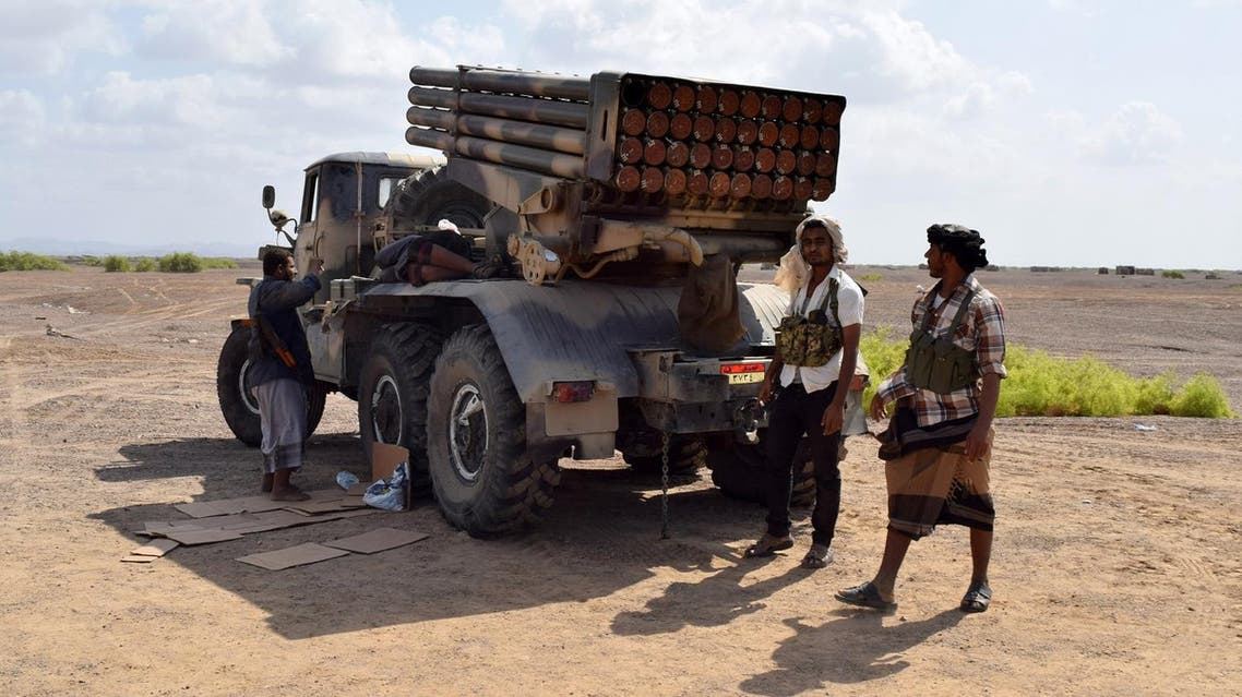 Fighters loyal to Yemeni President Abedrabbo Mansour Hadi rest next to a multiple rocket launcher in Bab al-Mandab. (AFP)
