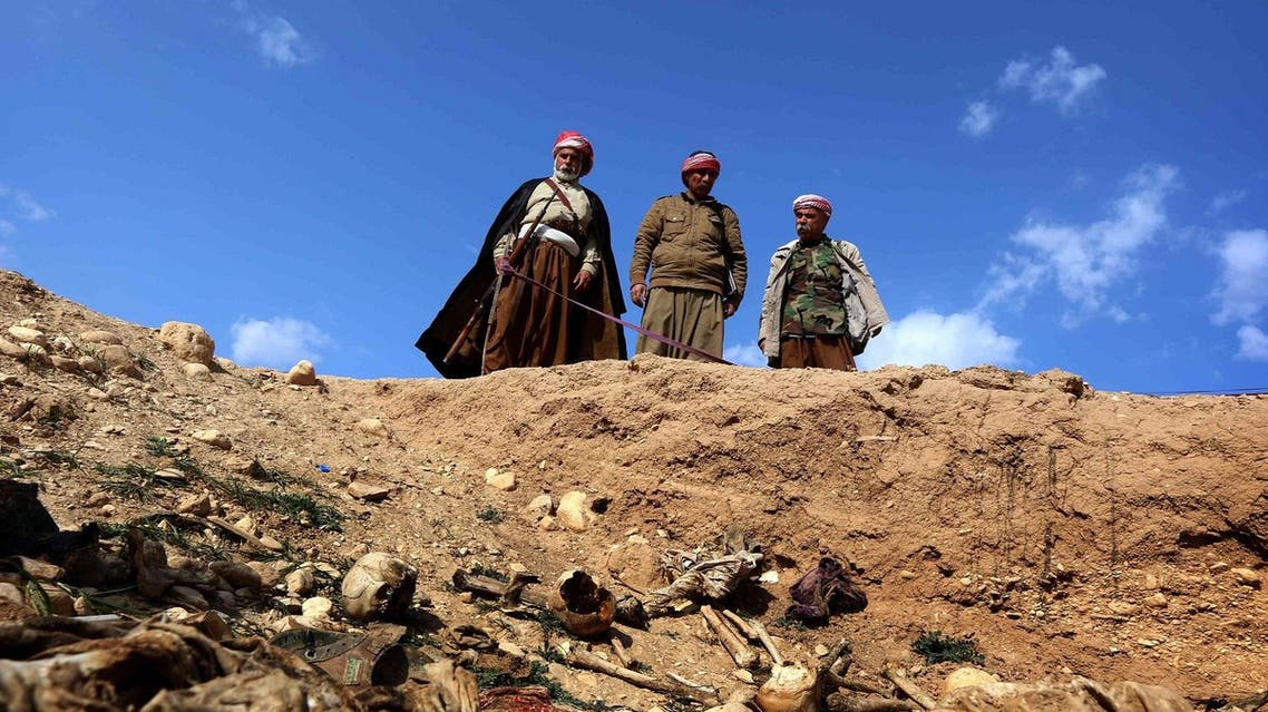 Members of the Yazidi minority search for clues on February 3, 2015, that might lead them to missing relatives in the remains of people killed by ISIS. (AFP)