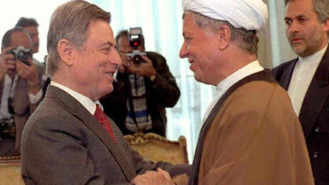 Syrian Vice-President Abdel Halim Khaddam (G) is greeted by Iranian President Ali Akbar Hachemi Rafsandjani 13 January, 1997, in Tehran. Khaddam was on a two-day official visit aimed at easing tensions between the two countries (Photo: AFP)