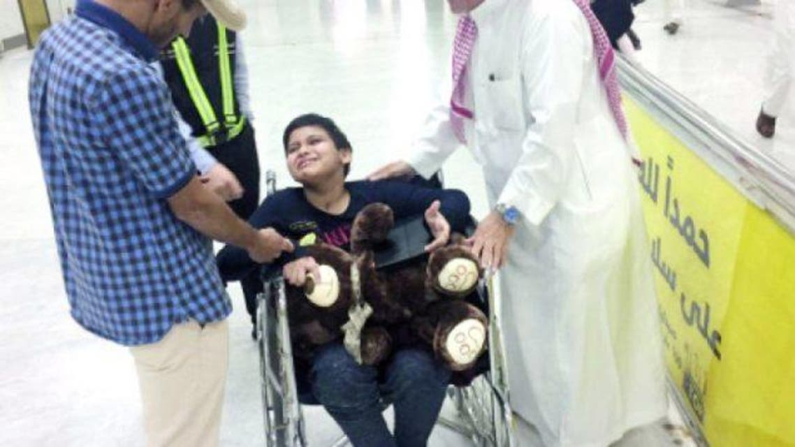 Jawad Al-Malki is in tears as he looks for his father at King Abdul Aziz International Airport in Jeddah. (Photo courtesy: Okaz)