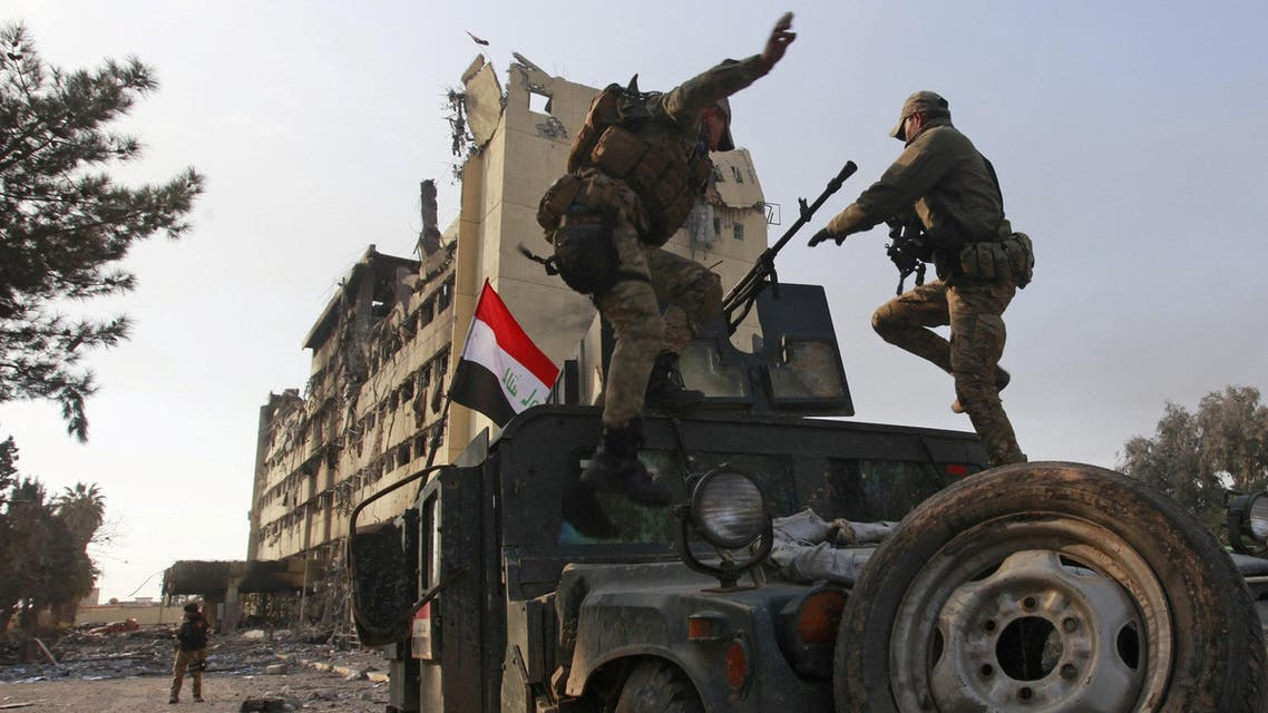 Members of the Iraqi rapid response forces stand on the top of vehicle during a battle between Iraqi forces and Islamic State militants in Wahda district of eastern Mosul, Iraq, January 8, 2017. (Reuters)