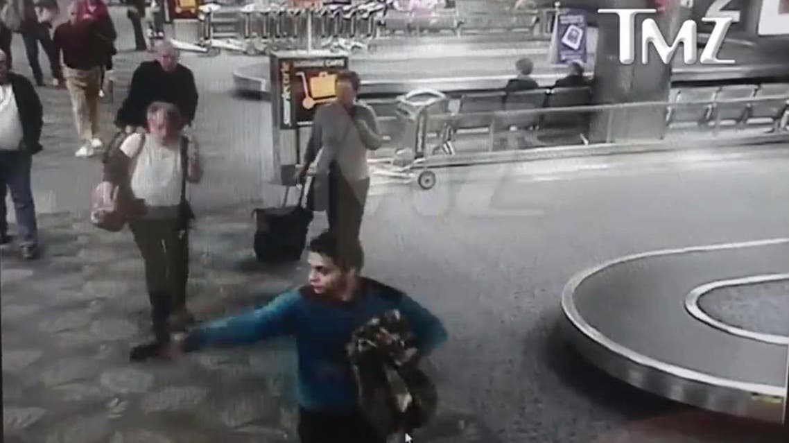 Video released by the TMZ website showed Santiago, bearded and wearing a blue shirt, walking calmly through the airport. (TMZ screengrab)