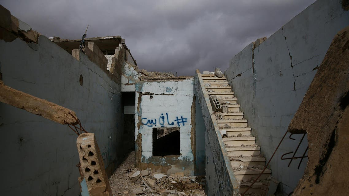 """Graffiti reading """"there is no house"""" in Arabic is sprayed on the wall of a damaged house in the rebel held besieged city of Douma, in the eastern Damascus suburb of Ghouta, Syria January 8, 2017. (Reuters)"""