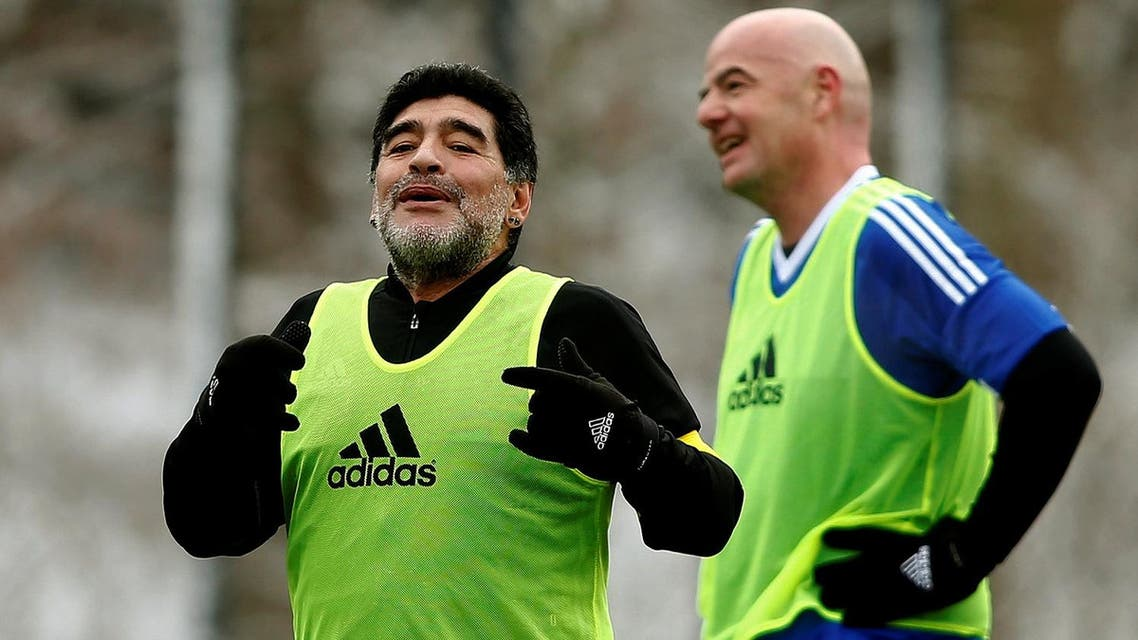 Maradona stands in front of FIFA President Infantino during the FIFA Legends tournament in Zurich. (Reuters)