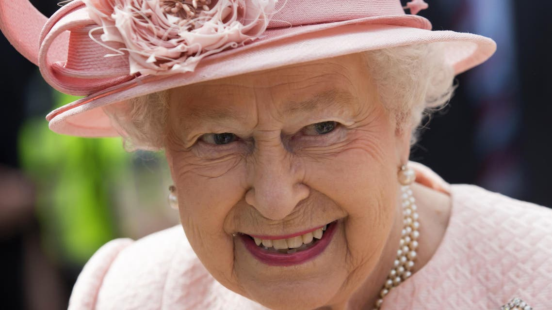 This file photo taken on June 22, 2016 shows Britain's Queen Elizabeth II reacting after arriving by Royal Train at Liverpool Lime Street Station in Liverpool, north-west England on June 22, 2016. AFP