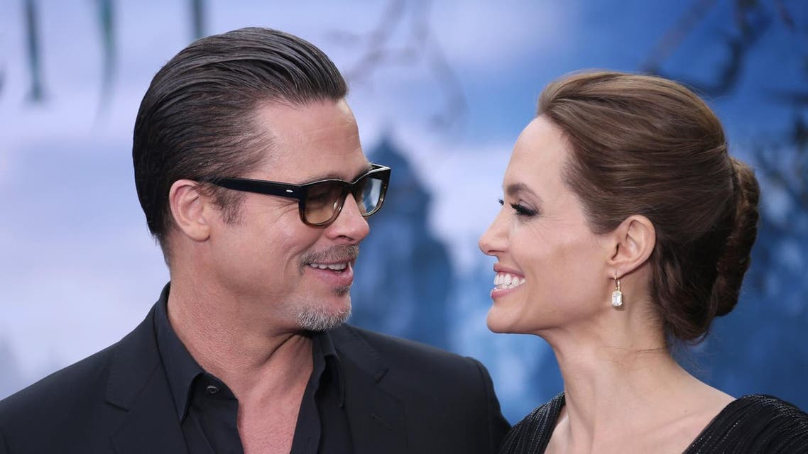 HAPPIER TIMES: Actors Brad Pitt and Angelina Jolie pose for photographers at a red carpet event in 2014 (Joel Ryan/Invision/AP)