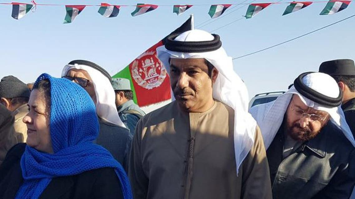 UAE Ambassador Juma Mohammed Abdullah al-Kaab, center, stands next to Nasrin Oryakhil, left, Afghanistan's minister of Labor, Social Affairs, Martyrs and Disabled, during an official ceremony of the Foundation for Khalifa bin Zayed Al Nahyan orphanage in Kandahar, Afghanistan. AP