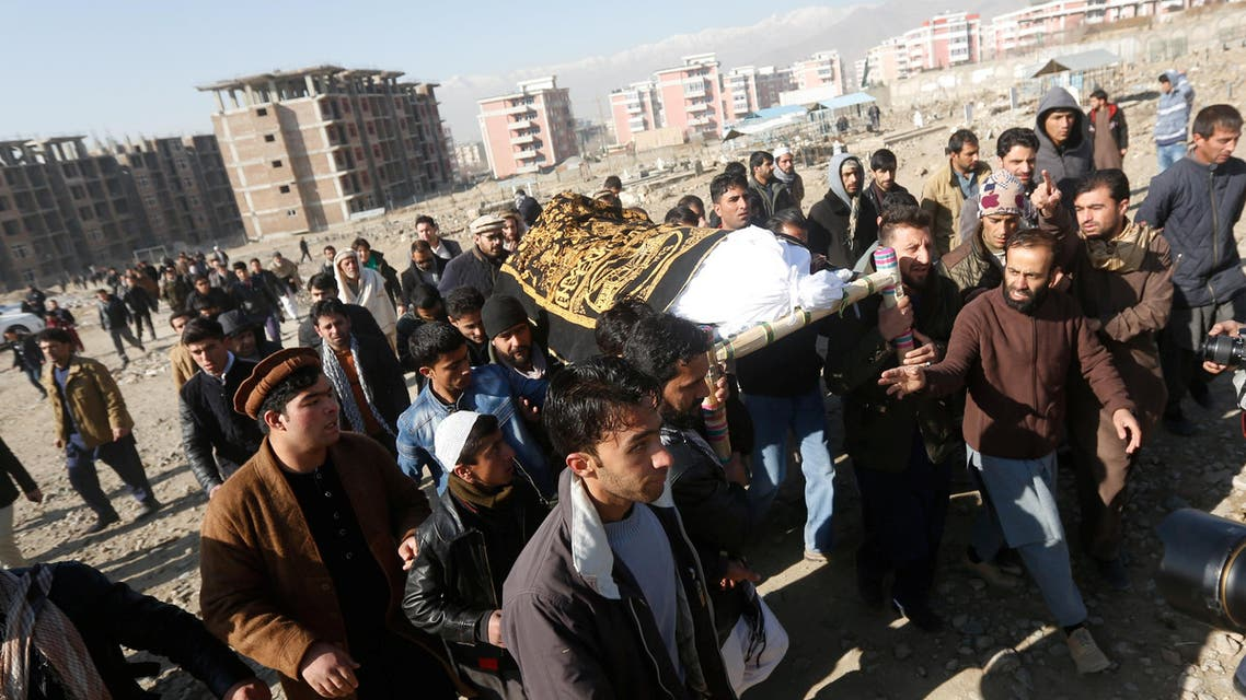 Afghan men carry the coffin of a victim for the burial ceremony a day after a suicide attack in Kabul, Afghanistan January 11, 2017