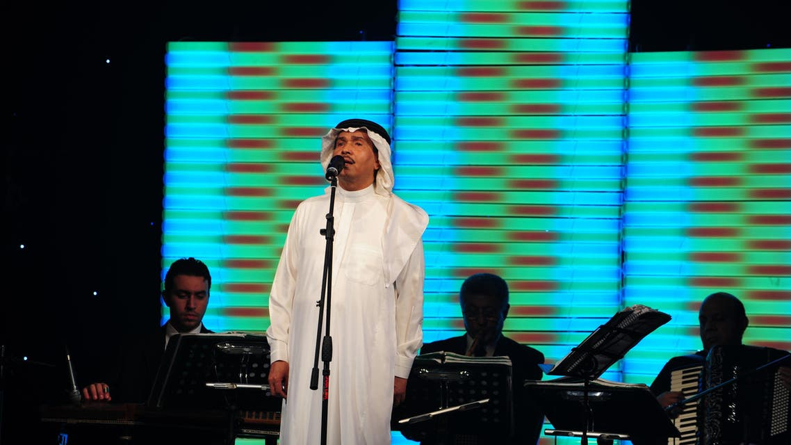 Saudi singer Mohammad Abdo gives a rare concert in the Red Sea port of Jeddah late on August 2, 2009. Saudi Arabia's most famous entertainer, who plays the oud, sings, and recites classical poetry in sold-out concerts around the Arab world, is taking part this year in Jeddah's summer festival at home. (AFP)