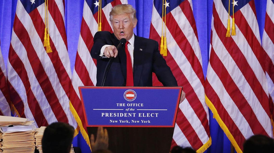US President-elect Donald Trump argues with CNN's Jim Acosta during a news conference in the lobby of Trump Tower in Manhattan. (Reuters)