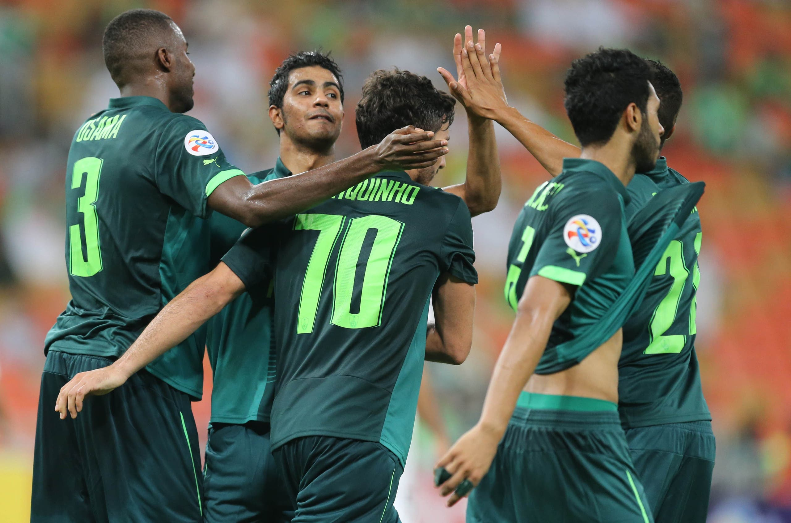 Saudi's Al-Ahli club players celebrate after scoring a goal during their AFC Champions League group D football match against Qatar's El-Jaish club at the King Abdullah Spots City in Jeddah on May 3, 2016. Al-Ahli won the match 2-0. (AFP)