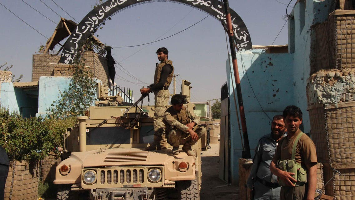 In this photograph taken on October 8, 2015, Afghan security forces stand guard at the main gate of the prison after retaking Kunduz from the Taliban, in Kunduz. (File photo: AFP)