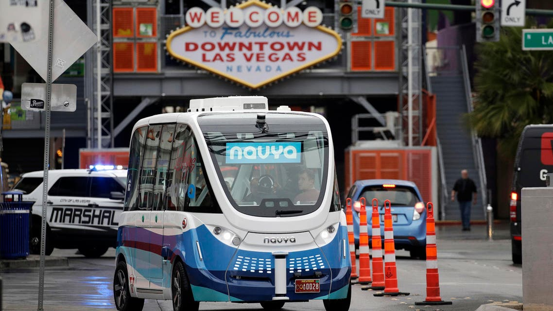 In this Jan. 12, 2017, photo, the Navya Arma autonomous vehicle drives down a street in Las Vegas. The driverless electric shuttle has begun carrying passengers in a test program in a downtown Las Vegas entertainment district. (AP)