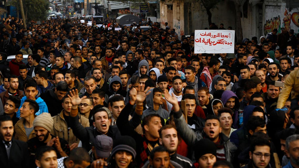 Palestinians chant slogans during a protest against the ongoing electricity crisis in Jabalia refugee camp in the northern Gaza Strip on January 12, 2017. (AFP)