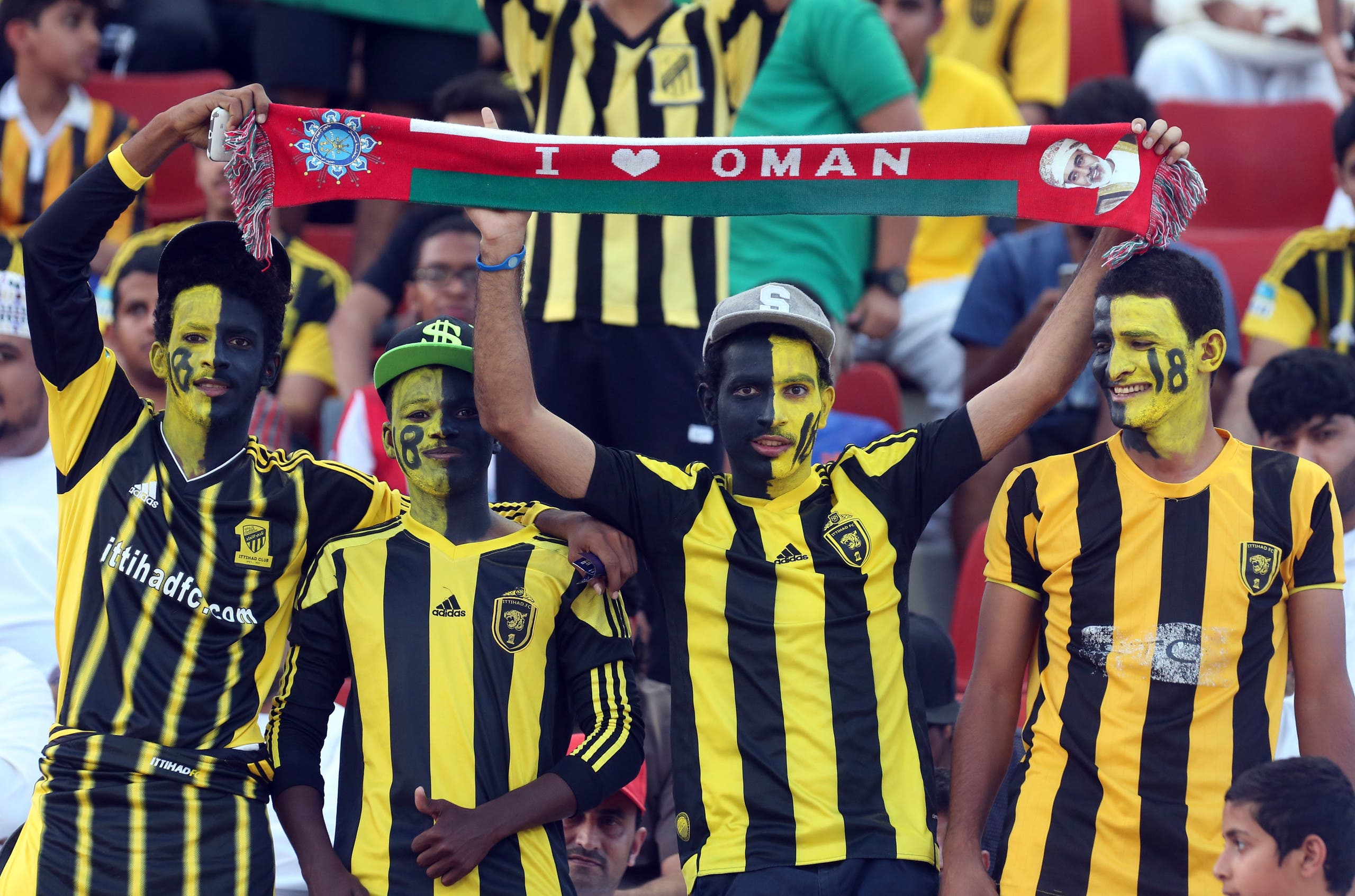 Saudi's Al-Ittihad club fans cheer on their team during their Asian Champions League group A football match against Iran's Sepahan club at the Sultan Qabous stadium in Muscat on May 4, 2016.  MOHAMMED MAHJOUB / AFP
