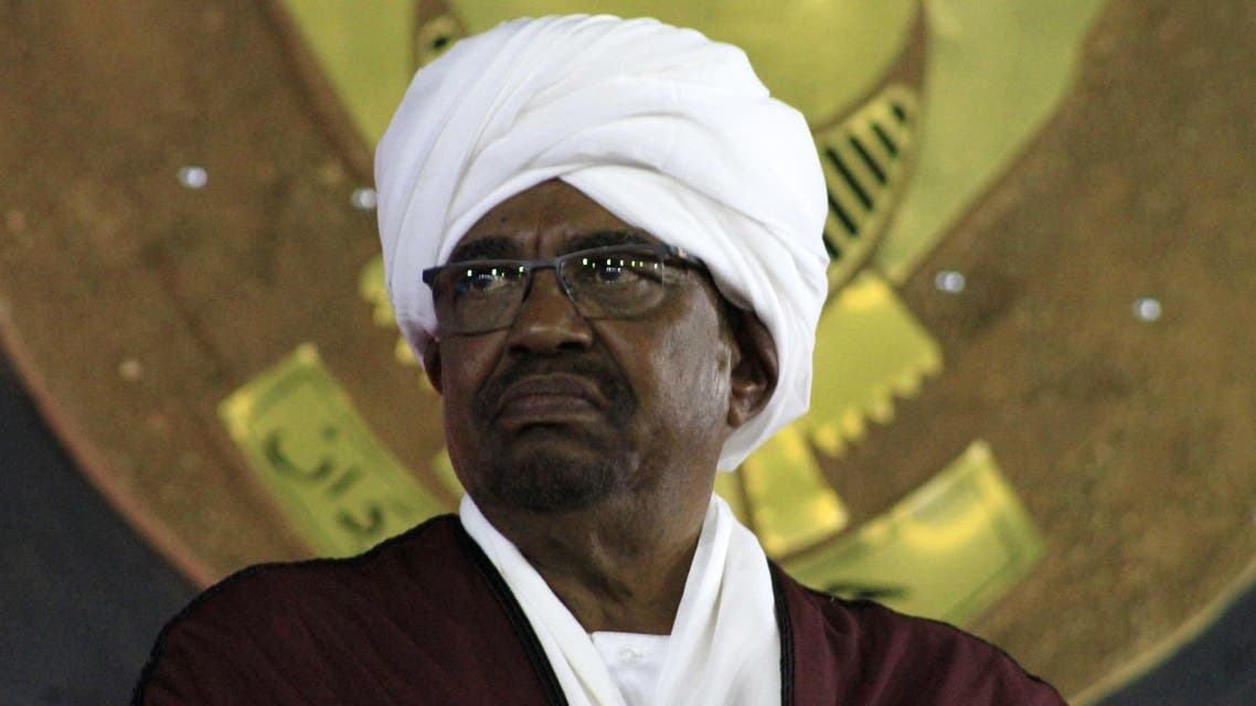 Sudanese President Omar al-Bashir (C) looks on during a celebration to mark the 61st anniversary of Sudan's independence from Britain, at the presidential palace in Khartoum, on December 31, 2016. (AFP)