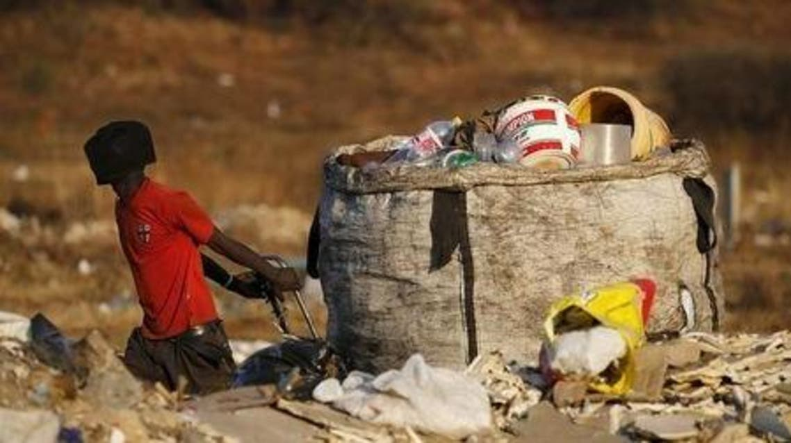 An unemployed man pulls a trolley full of recyclable waste material which he sells for a living, in Daveland near Soweto, South Africa August 4, 2015. (Reuters)