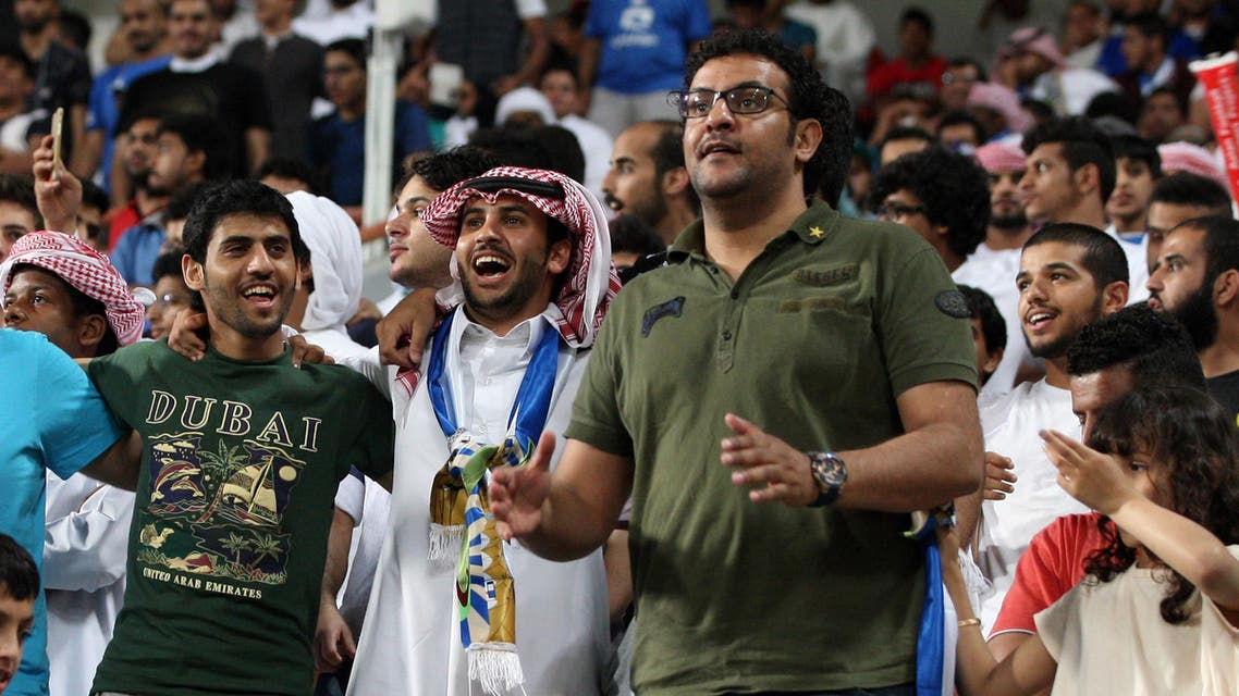 Supporters of Saudi club Al-Hilal cheer during an Asian Champions League group C football match against Emirati club Al-Jazira at Mohammed Bin Zayed Stadium on March 15, 2016 in Abu Dhabi. (AFP)