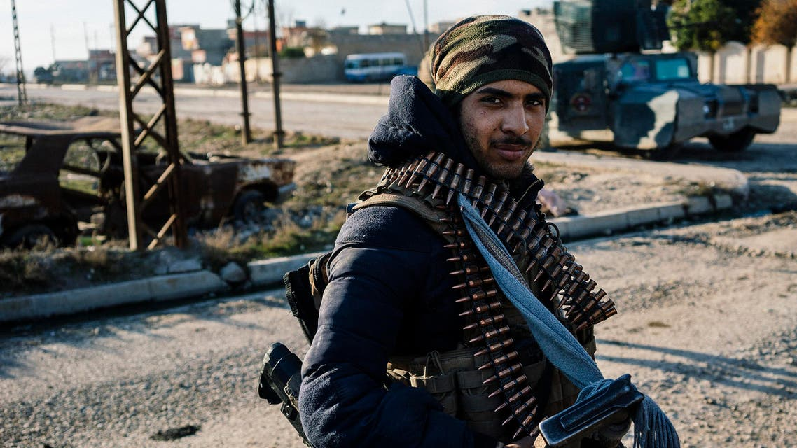 An Iraqi member of the Rapid Response Division stands in a street in Mosul's Yarimjah neighbourhood on January 12, 2017. (AFP)