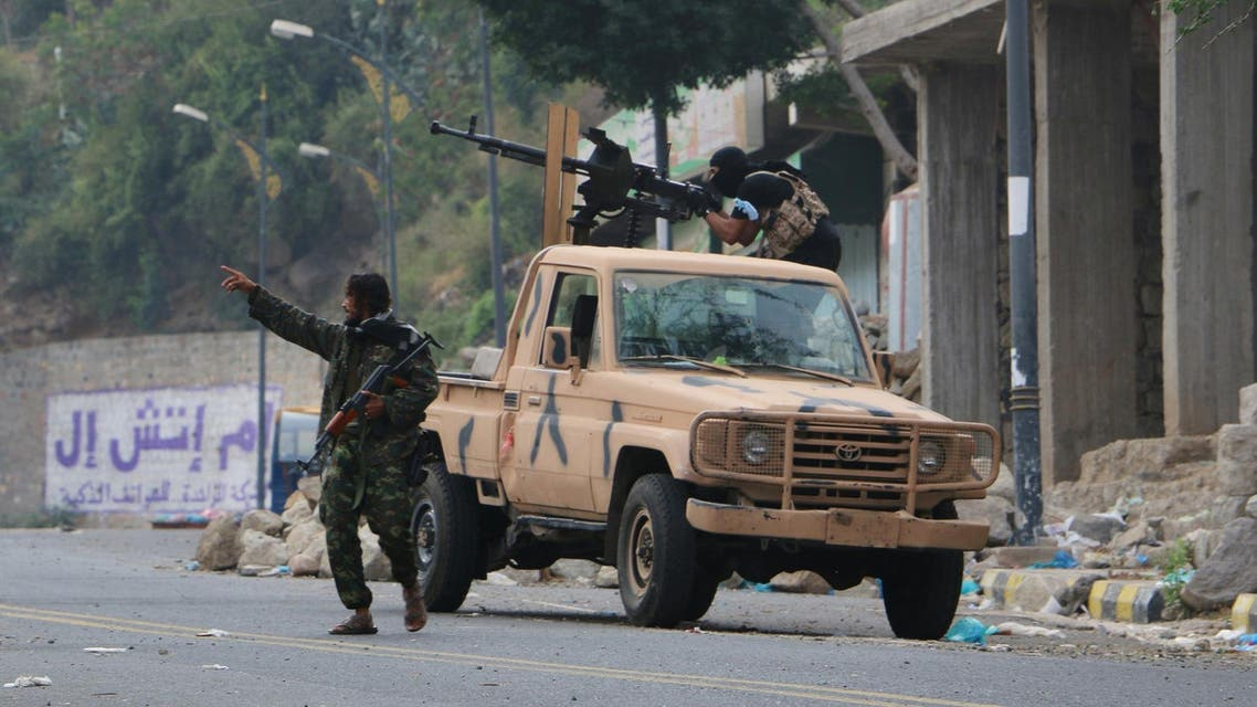 Tribal fighters take position on a street during fighting with Shiite rebels known as Houthis, in Taiz, Yemen, Tuesday, Dec. 15, 2015. ap