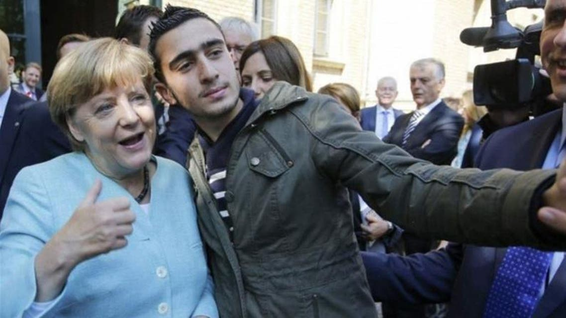 Anas Modamani takes a selfie with Angela Merkel in Berlin in September 2015. Photograph