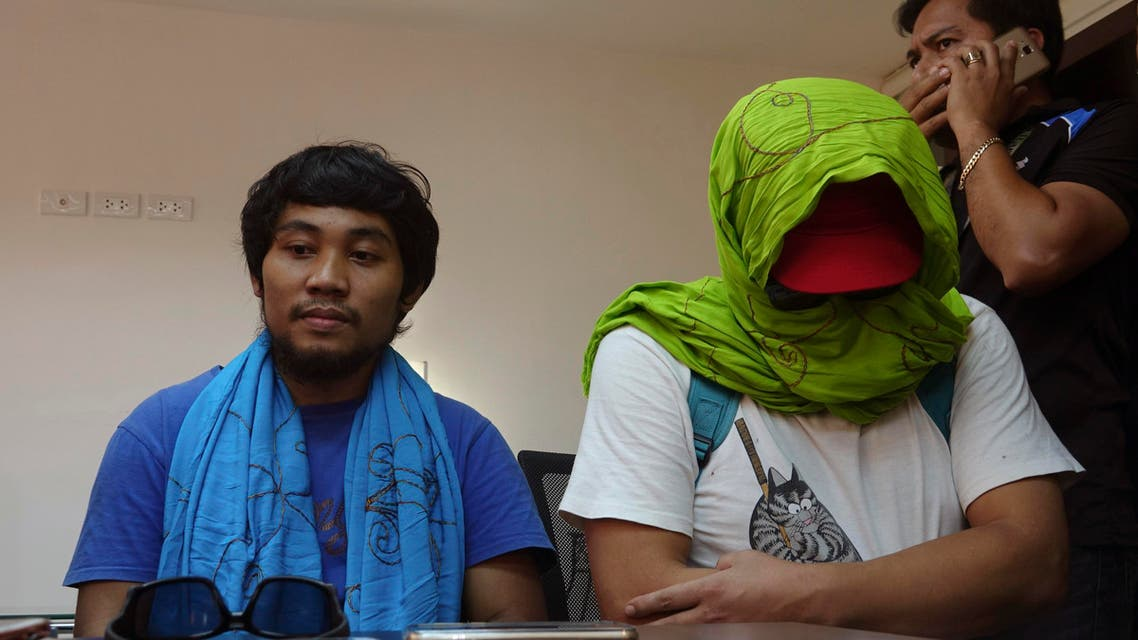 South Korean hostage Park Chul-hong, seated right, and Filipino hostage Glen Alindajao, left, prepare to answer questions after being flown in Davao from Jolo following their release Saturday, Jan. 14, 2017 from their kidnappers in the volatile island of Jolo in southern Philippines. (AP)