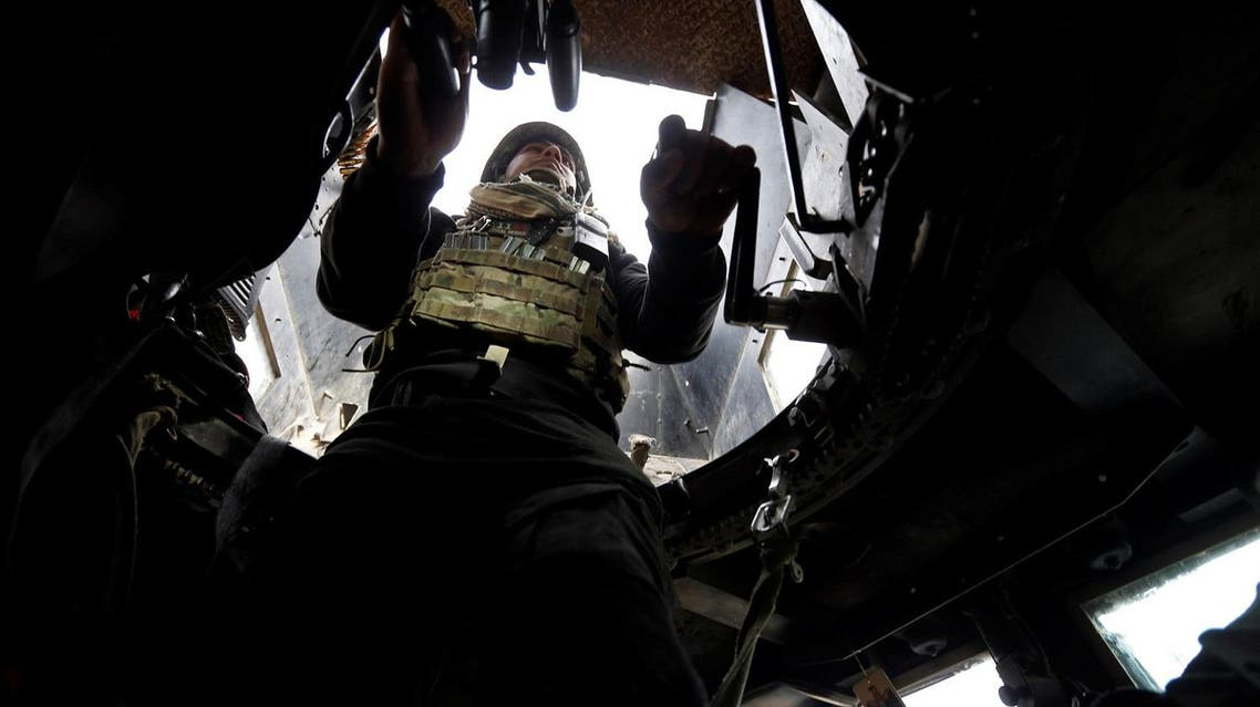 A member of Iraqi Special Operations Forces (ISOF) sits in a military vehicle during clashes with ISIS militants in frontline near university of Mosul. (Reuters)