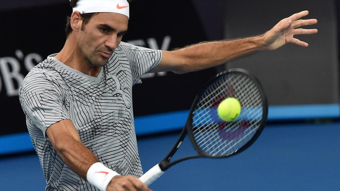 Roger Federer of Switzerland hits a return during a practice session ahead of the Australian Open tennis tournament in Melbourne on Jan. 15, 2017 (Photo: Paul Crock/AFP)