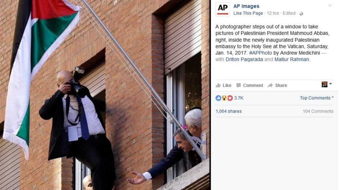 Palestinian President Mahmoud Abbas, right, looks out a window of the newly inaugurated Palestinian embassy to the Holy See at the Vatican, Saturday, Jan. 14, 2017. (AP/ Facebook)