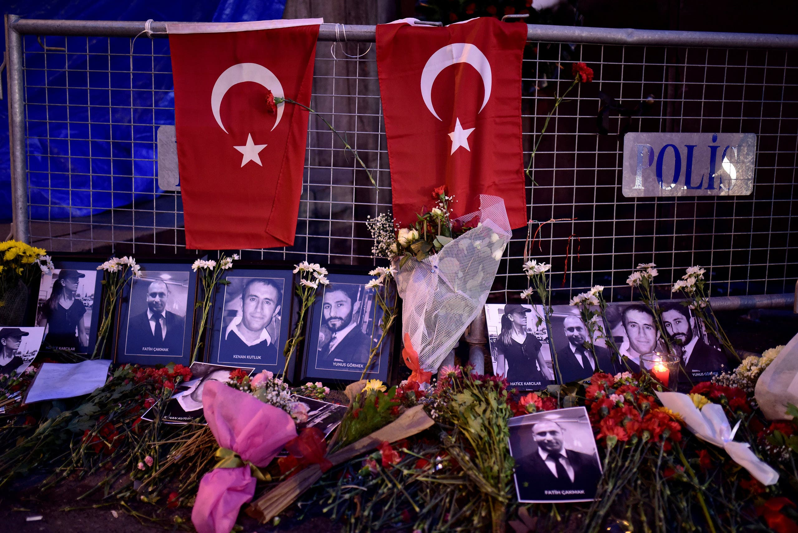 Flowers and pictures of the victims are placed near the entrance of Reina nightclub, which was attacked by a gunman, in Istanbul, Turkey January 2, 2017