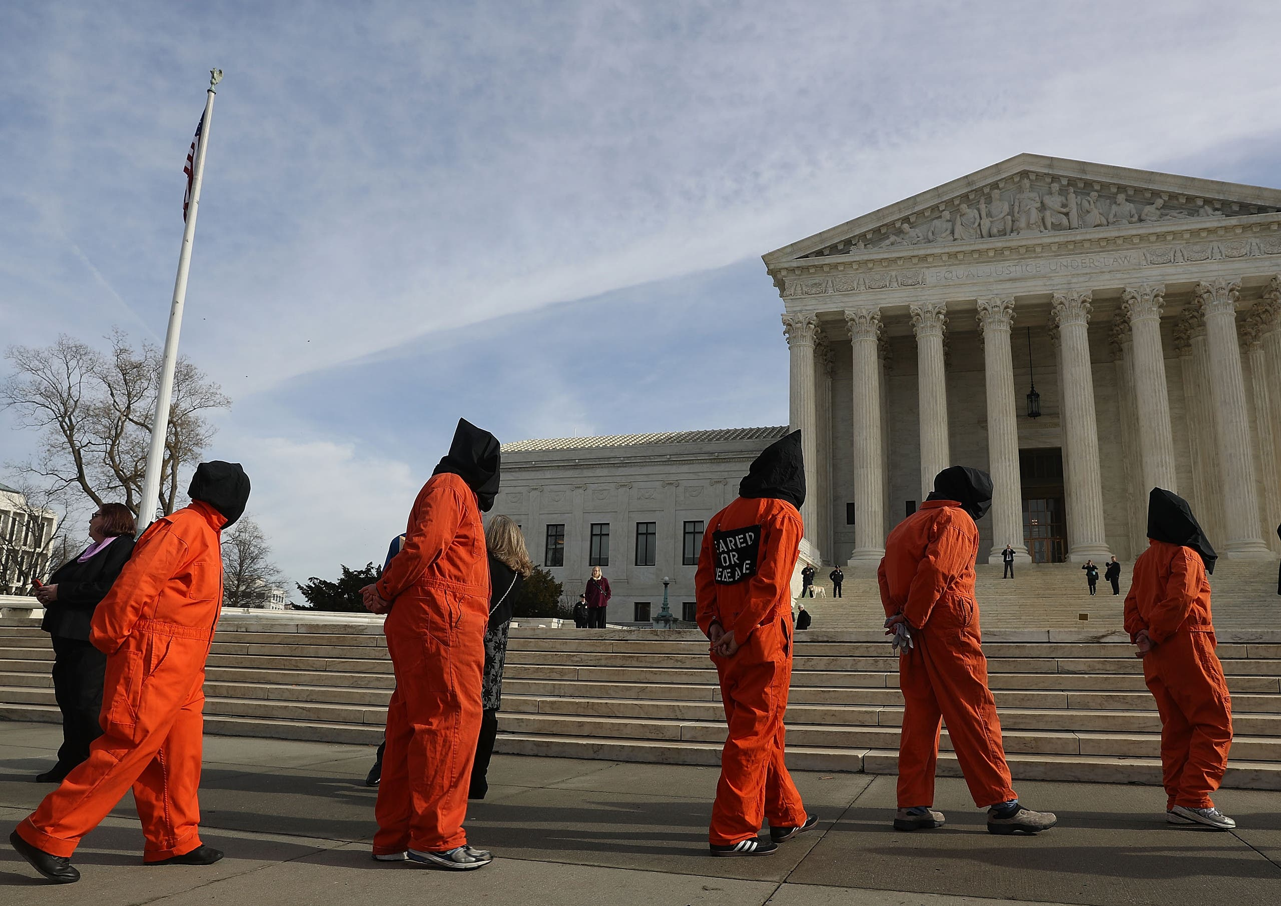 Protesters gather in front of the US Supreme Court to mark 15 years since the first prisoners were brought to the US detention facility in Guantanamo Bay, Cuba on January 11, 2017 in Washington, DC. (AFP)