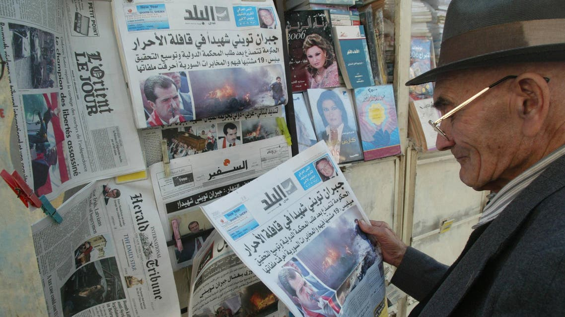 A Lebanese man reads a newspaper with the news of yesterday's car bomb attack that killed lawmaker and journalist Gebran Tueini dominating the front pages of local and international dailies, in Beirut 13 December 2005. Lebanon was grappling with fresh political turmoil today as it mourned the killing of the leading anti-Syrian journalist the day before. Another three people, including his driver and a bodyguard, were killed in the attack, the latest deadly strike against anti-Damascus figures. AFP PHOTO/ANWAR AMRO