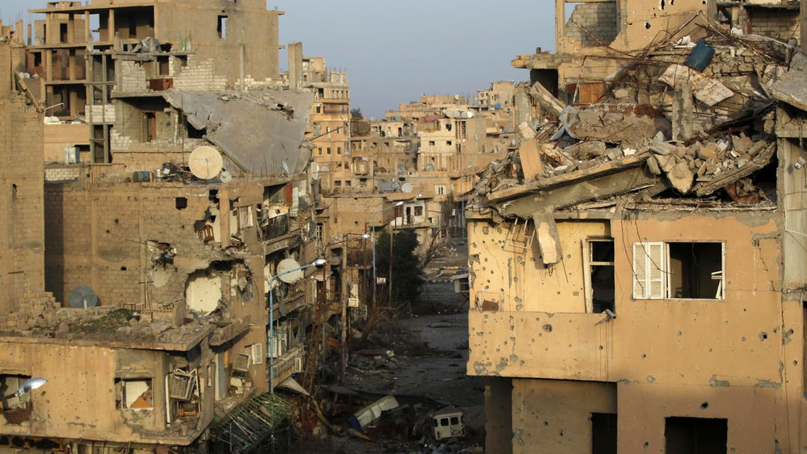 A view shows damaged buildings in Deir al-Zor, eastern Syria February 19, 2014. Picture taken February 19, 2014. REUTERS/Khalil Ashawi (SYRIA - Tags: CONFLICT CIVIL UNREST)gs: POLITICS CIVIL UNREST CONFLICT)