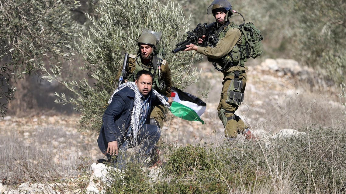 Israeli soldiers detain a Palestinian protester during clashes following a protest against the near-by Jewish settlement of Qadomem, in the West Bank village of Kofr Qadom near Nablus December 30, 2016