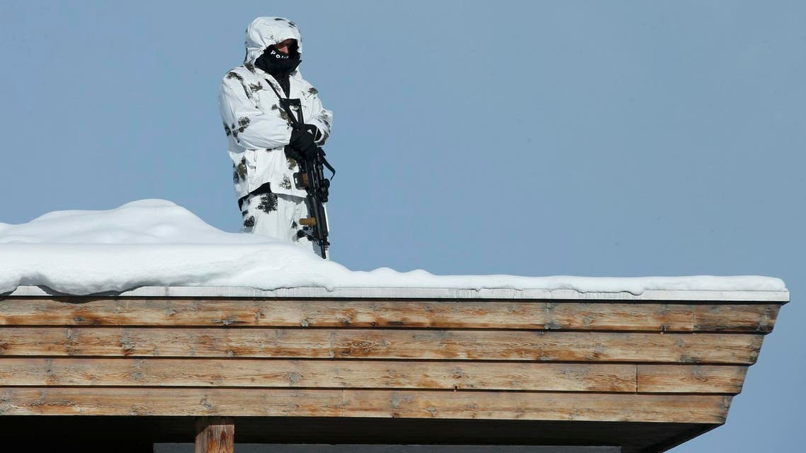 Swiss special police officer observes the area from atop the roof of the Congress Hotel ahead of the annual meeting of the World Economic Forum (WEF) in Davos. (Reuters)