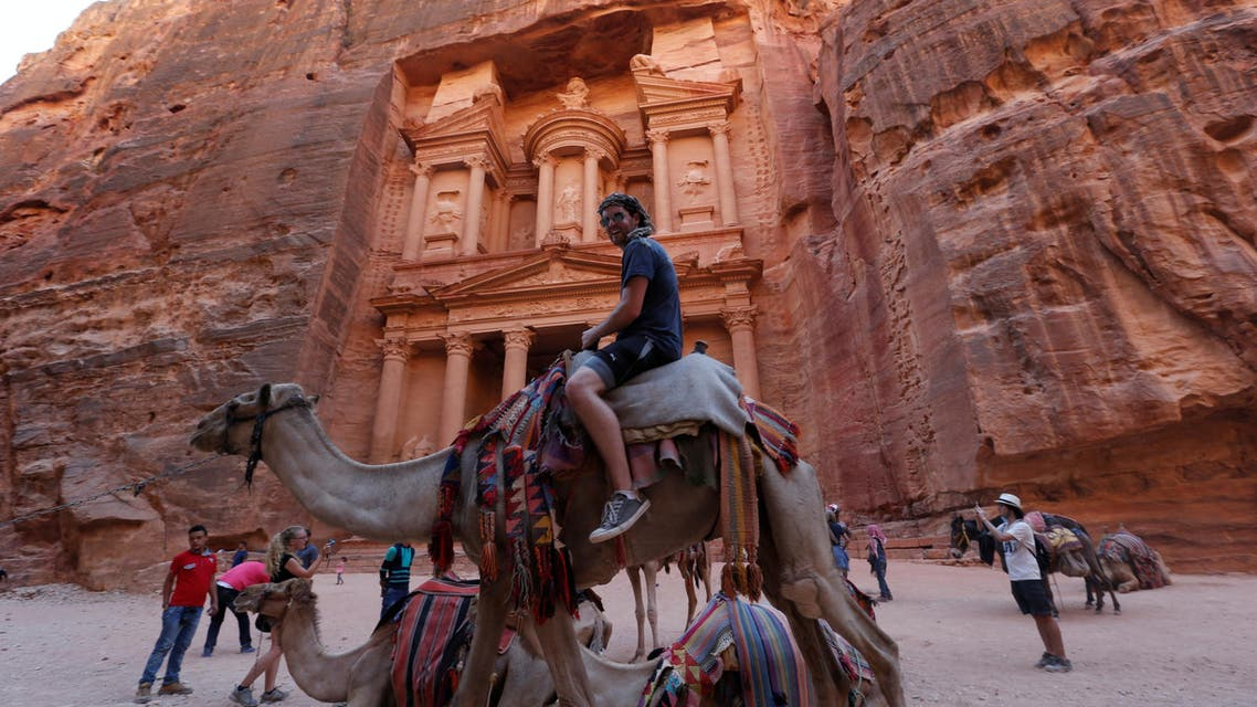 Tourists take pictures in front of the Treasury site during their visit to the ancient city of Petra, south of Amman, Jordan, July 23, 2016. (Reuters)
