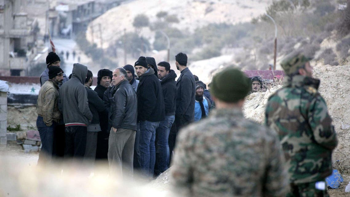A handout picture released by the official Syrian Arab News Agency (SANA) on January 11, 2017 shows civilians living in the villages of the rebel-held Wadi Barada area of rural Damascus waiting to have their documents checked by government officials before being granted safe passage out of the area. Syria's government has reached a deal for the army to enter a rebel-held area near Damascus and restore the capital's water supply, the provincial governor said. Opposition sources denied there was any such deal, but a source inside the Wadi Barada region reported several hundred civilians were leaving under an agreement. AFP