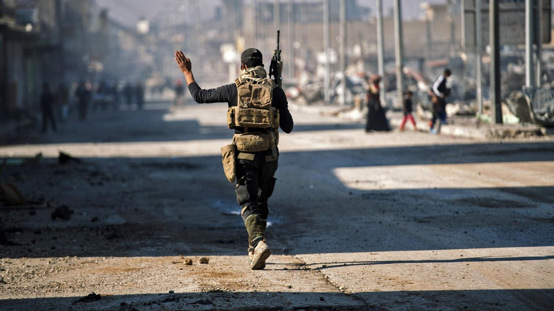 A member of the Iraqi special forces Counter Terrorism Service (CTS) patrols a street in eastern Mosul on January 18, 2017. (AFP)