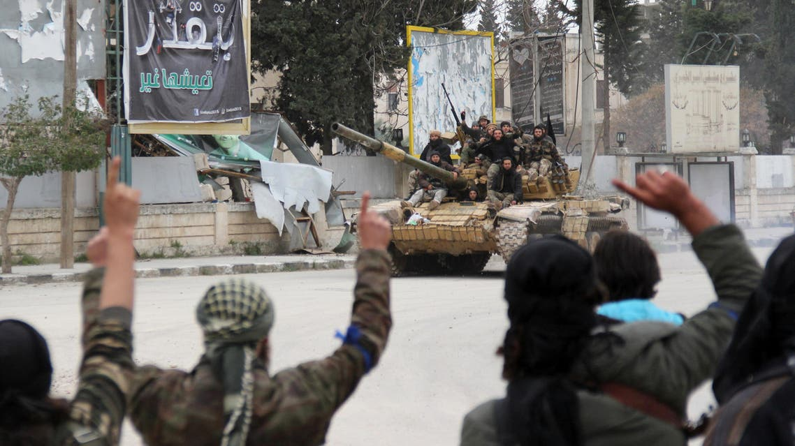Militant fighters greet each other on March 28, 2015 in the Syrian city of Idlib. (File photo: AFP)