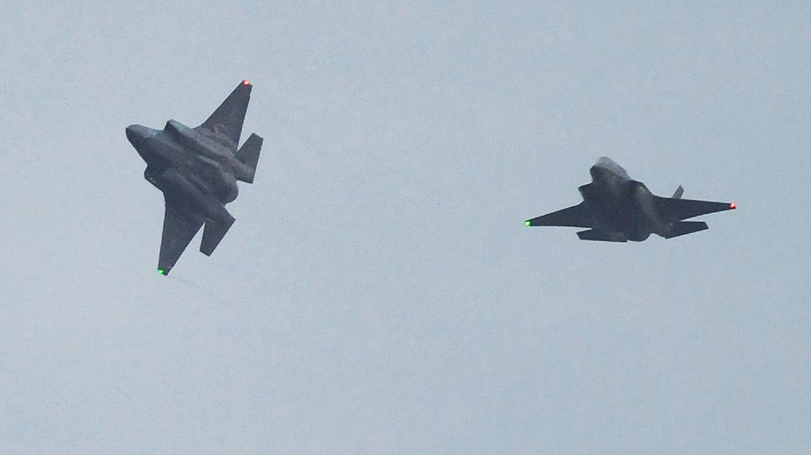 This picture taken on January 18, 2017 shows two US F-35B stealth fighter jets flying over the US Marine's Iwakuni Air Station in Iwakuni, Yamaguchi prefecture. The US Marine Corps said on January 11 it was sending a squadron of F-35B fighter jets to Japan, marking the first operational overseas deployment for the controversial aircraft that is under scrutiny from President-elect Donald Trump. AFP