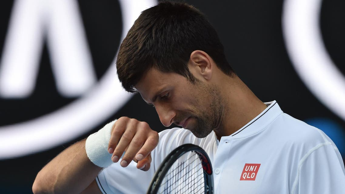 Serbia's Novak Djokovic reacts after a point against Uzbekistan's Denis Istomin during their men's singles second round match on day four of the Australian Open tennis tournament in Melbourne on January 19, 2017. AFP