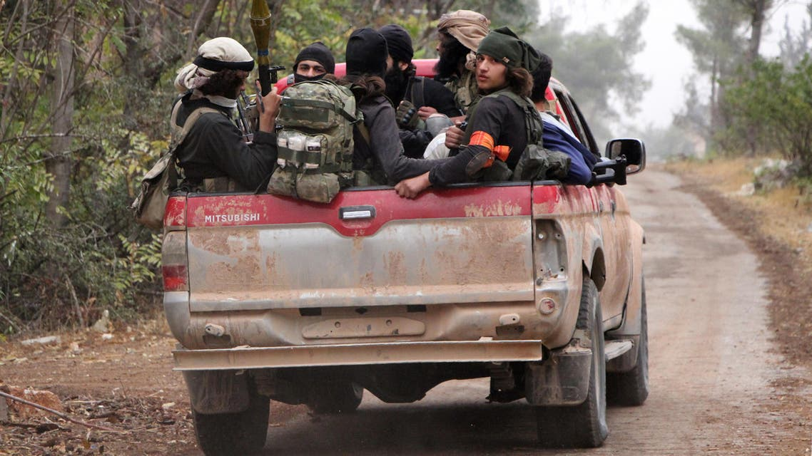 Rebel fighters from the Jaish al-Fatah brigades sit in the back of a truck as they take part in a major assault on Syrian government forces West of Aleppo city on October 28, 2016. (File photo: AFP)