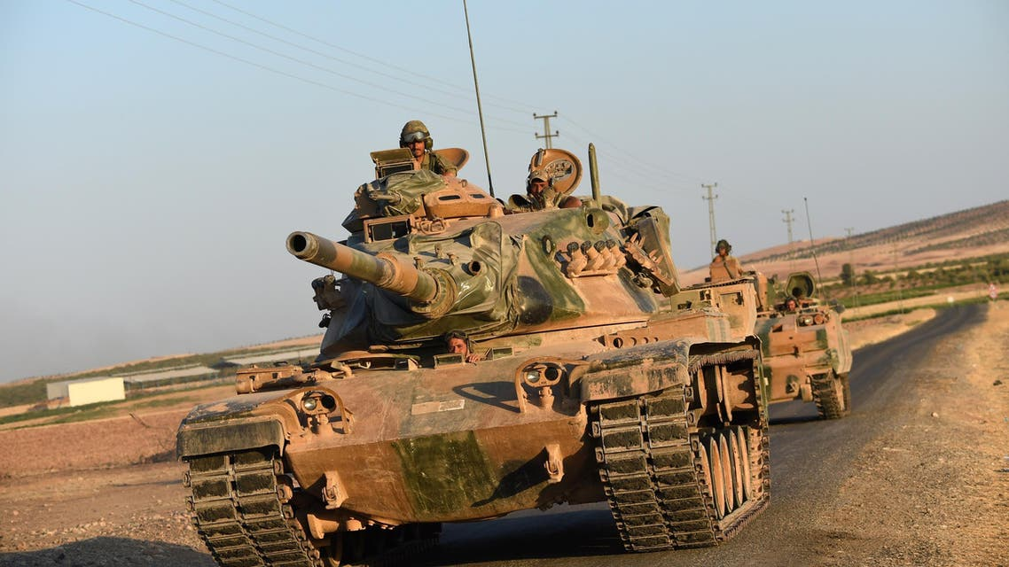 Turkish soldiers stand in a Turkish army tank driving back to Turkey from the Syrian-Turkish border town of Jarabulus on September 2, 2016 in the Turkish-Syrian border town of Karkamis. (AFP)