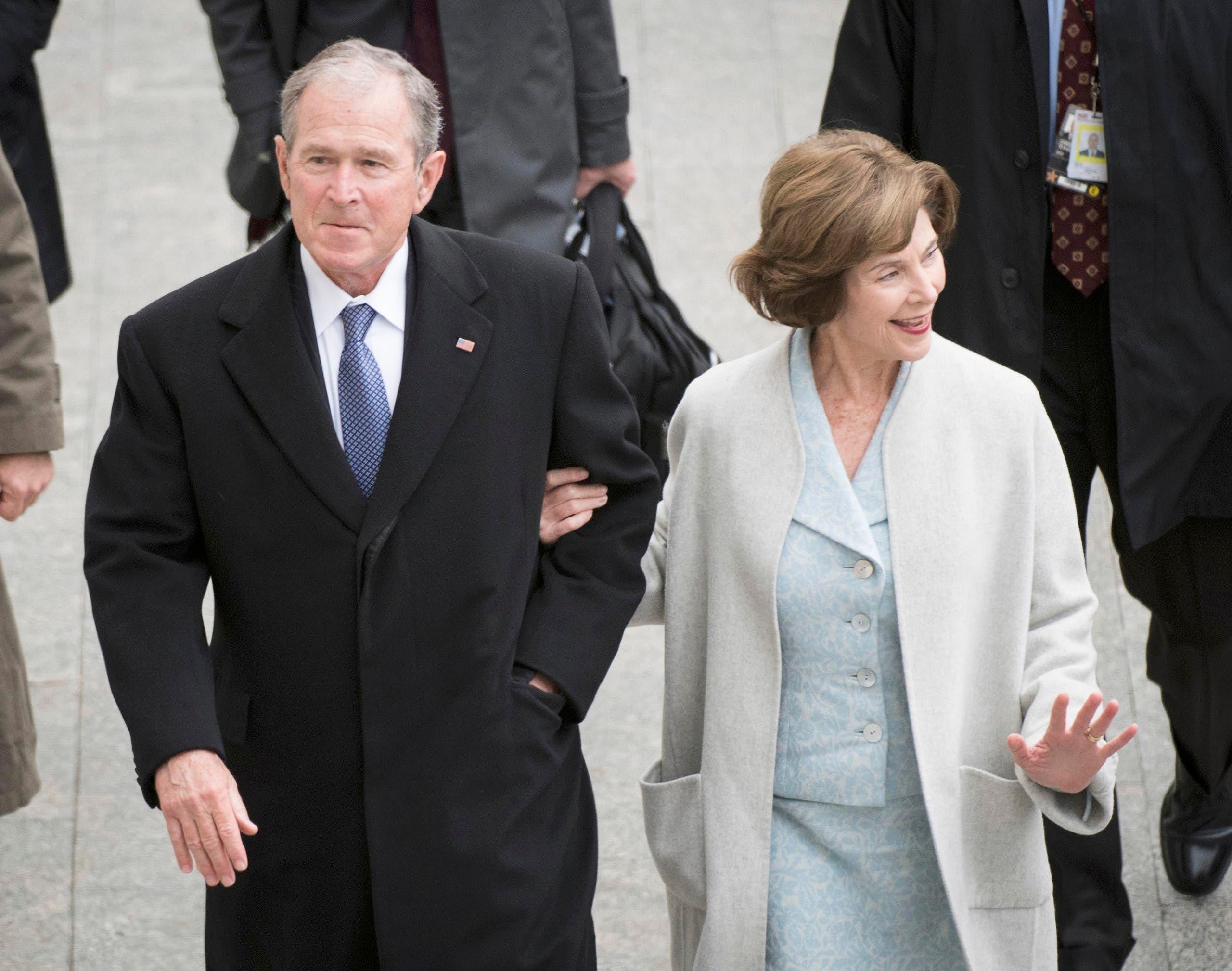 الرئيس الأميركي الأسبق جورج بوش الابن وزوجته لورا