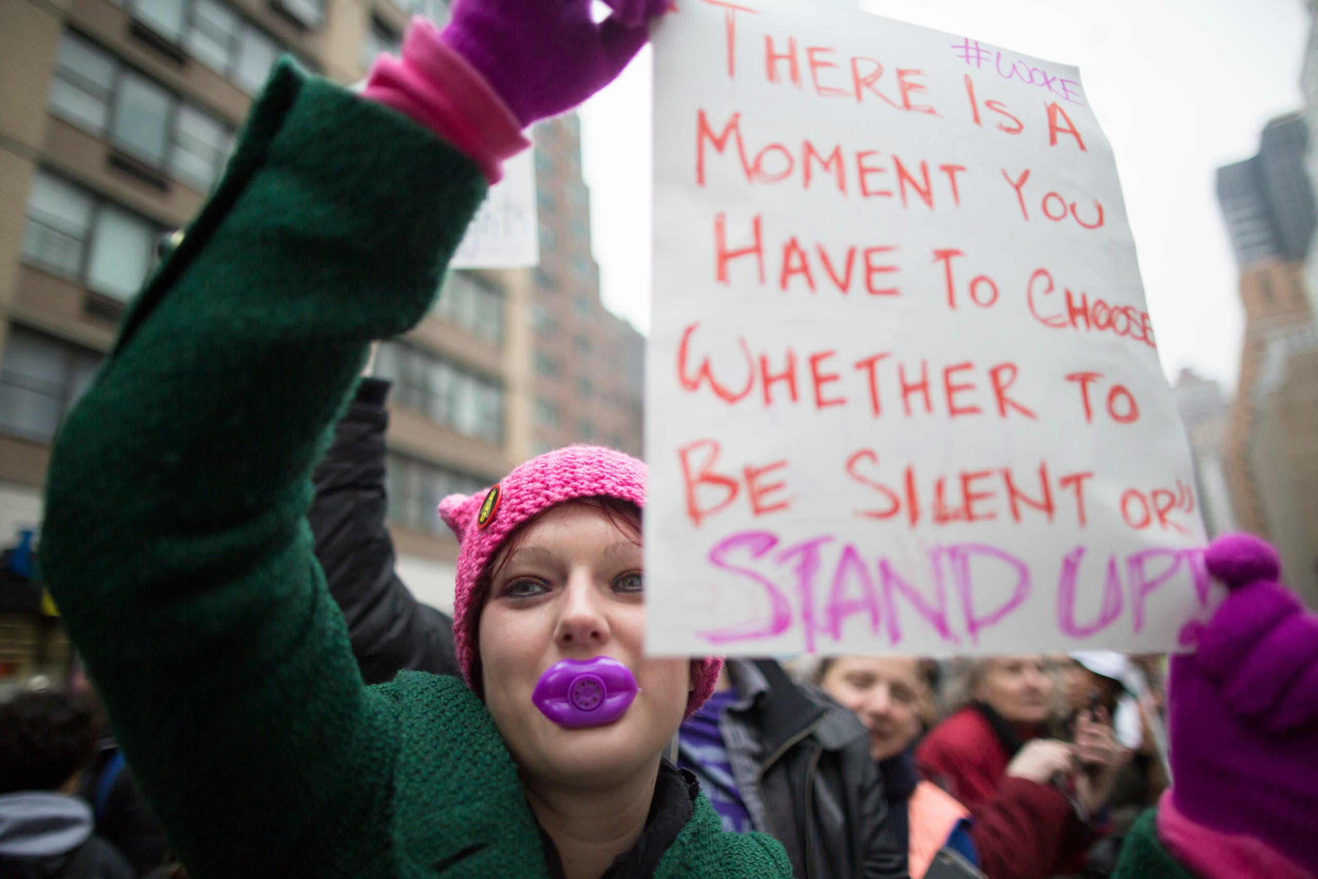 Suzie McCarthy of Jersey City, New Jersey, participates in a women's march in New York. (AP)