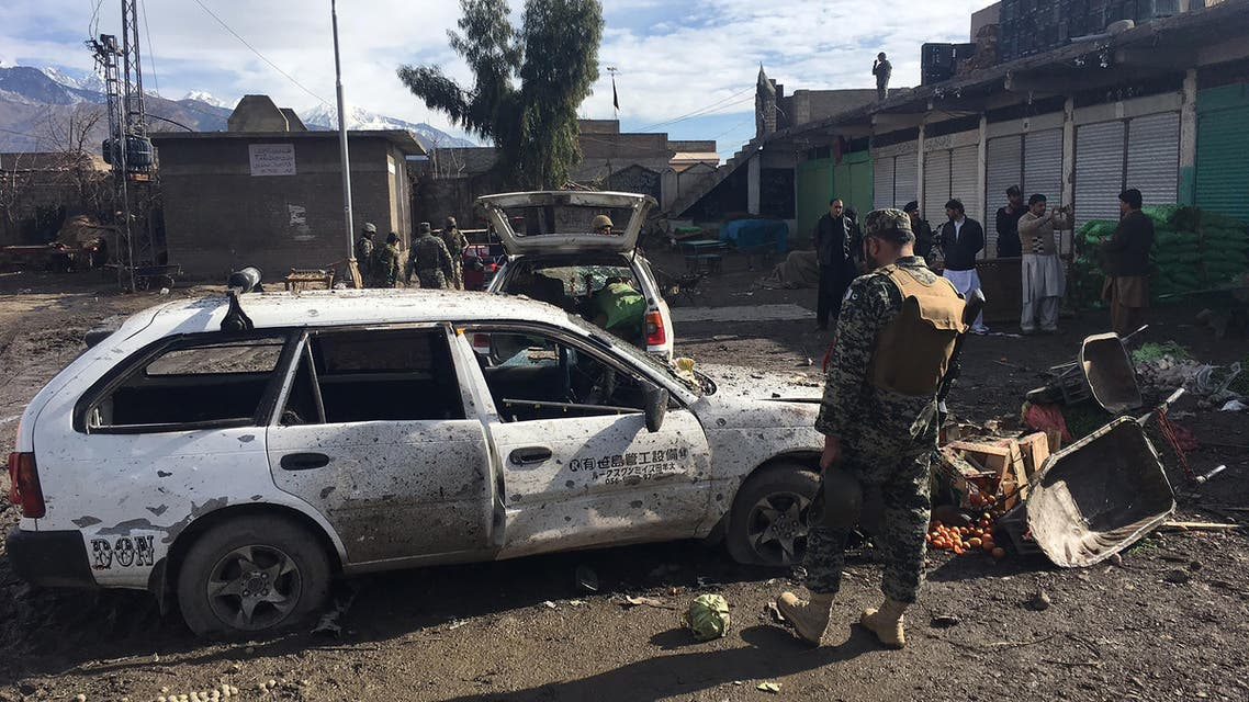 Pakistani security officals inspect the bomb explosion site at a vegetable market in Parachinar city, the capital of Kurram tribal district on the Afghan border on January 21, 2017. AFP