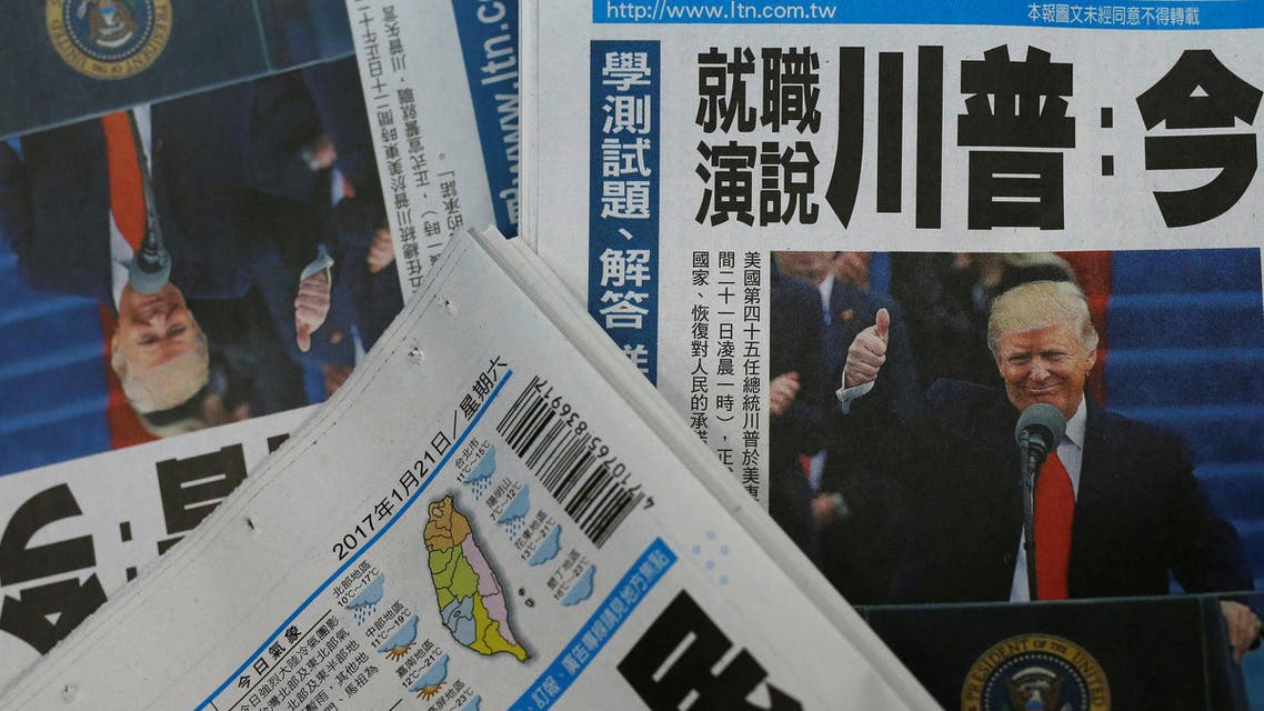 Copies of Taiwanese daily newspaper Liberty Times, with its frontpage on the inauguration of U.S. President Donald Trump, are seen a printing house in Taipei, Taiwan January 21, 2017. REUTERS/Tyrone Siu