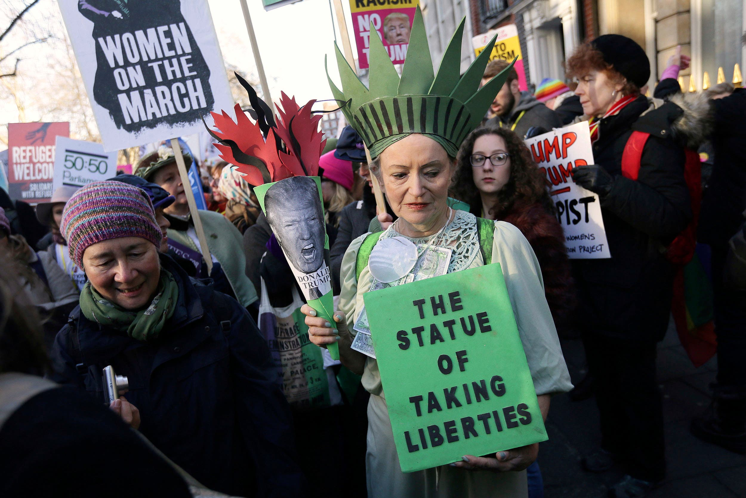 Demonstrators take part in the Women's March on London, following the Inauguration of U.S. President Donald Trump, in London, Saturday Jan. 21, 2016. (AP)